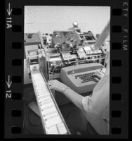 Carte Blanche credit cards being feed into printing machine, 1967