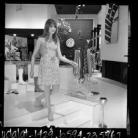 Model wearing vinyl dress at Paraphernalia boutique in Beverly Hills, Calif., 1967