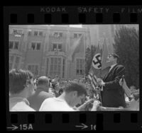 John Coffman, president of Committee for Rhodesian Independence in Support of Ian Smith, speaking to crowd at UCLA, 1967