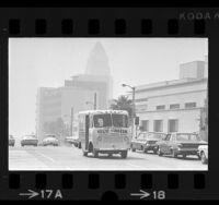 Los Angeles Department of Water and Power's electric-powered truck driving down street on smoggy day, 1967