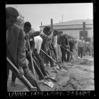 Line of Watts residents digging foundation for Watts Towers Art Center, 1967