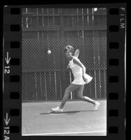Mrs. James Mitchell of Hancock Park playing tennis, Calif.,  1967