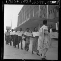 Los Angeles Biafra Student Association members, in native African garb, picketing the Los Angeles Federal Building, 1967