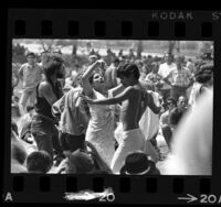 Couples dancing amongst crowd at love-in held at Griffith Park, Los Angeles, 1967