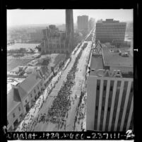 Birds-eye view of demonstrators walking down Wilshire Blvd. in peace parade, Los Angeles, Calif., 1967