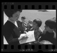 Shirley Temple Black signing autographs for children in Los Angeles, Calif., 1967