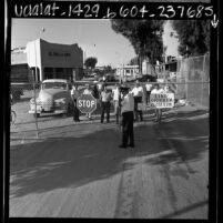 Mexican citizens waiting at U.S.- Mexican border gate in Andrade, Calif., 1967