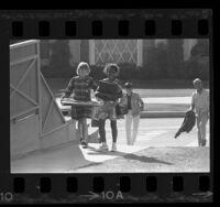 Four school children walking home in Inglewood, Calif., 1967