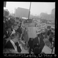 Pickets, on the steps of the Federal Building in downtown Los Angeles, protesting funding cuts for anti-poverty programs, 1967