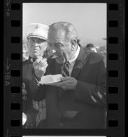 Close-up of President Lyndon Johnson eating a slice of cake at Camp Pendleton, Calif., 1967