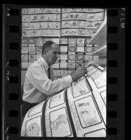 Hanna-Barbera production supervisor, Carl Urbano working on a storyboard, 1967