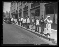 Men and women of the Los Angeles Public Works and Unemployed Union picketing outside W.P.A. headquarters, 1936
