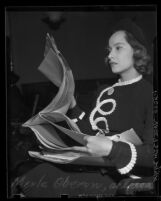 Actress Merle Oberon reviewing court papers in suit  by her former attorney, Lyle W. Rucker, Calif., 1938