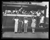 Chinese American children waving from a car at picnic sponsored by Chinese Ladies' Union Missionary Society, Calif., 1936