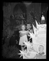 Shirley Temple and Eddie Cantor cutting President Franklin D. Roosevelt's birthday cake in Los Angeles, Calif., 1937