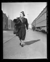 Actress Gloria Swanson arriving in Los Angeles, Calif., 1937