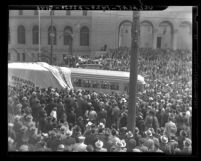 Crowd at City Hall watching unveiling of new Los Angeles Railway streetcars at Transportation Week celebration, 1937