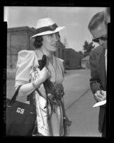 Actress Gloria Swanson talking to reporters as she arrives in Los Angeles, Calif., 1937