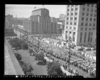 Labor Day parade as it passes by City Hall, with the State Building and The Times Building in Los Angeles, Calif., 1937