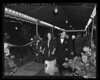 "Spencer Tracy and wife, Louise walking the red carpet at motion picture premiere of ""Life of Emile Zola"" in Los Angeles, Calif., 1937"