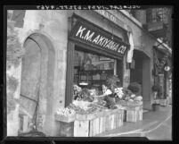 Japanese American grocer at K. M. Akiyama Co. in Little Tokyo, Los Angeles, Calif., 1937