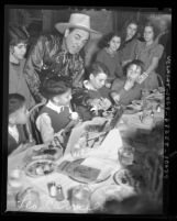 Actor Leo Carrillo hosting Thanksgiving dinner for Mexican American children at La Golondrina restaurant in Los Angeles, Calif., 1937