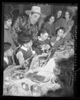Actor Leo Carrillo hosting Thanksgiving dinner for Mexican American children at La Golondrina restaurant in Los Angeles, Calif., 1937