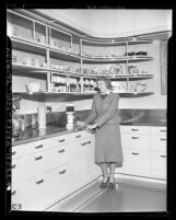 "Anna Marie Peters in ""Modern California"" kitchen exhibit at Southern California Home Show, 1938"