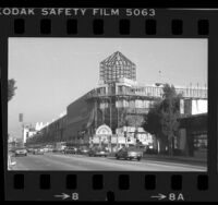 View from across Pico Blvd. at construction of tower and skylights for Westside Pavilion in Los Angeles, Calif., 1985