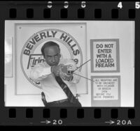 Arthur Kassel demonstrates use of a taser (stun gun) at Beverly Hills Gun Club, Calif., 1985