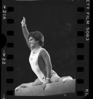 Gymnast Mary Lou Retton performing on the beam during Olympic Vidal Sassoon Looking Good Tour in Los Angeles, Calif., 1985