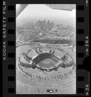 Aerial view of Dodger Stadium with downtown Los Angeles in background, 1985