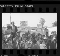 "Apartheid protesters with sign reading ""No Grammy to Artists Who Entertain Apartheid,"" outside the Grammy Awards in Los Angeles, Calif., 1985"