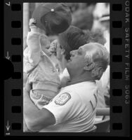 Dodger's manager Tommy Lasorda playing with shortstop, Dave Anderson's daughter, Christa, 1985