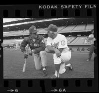 Tommy Lasorda talking with Cincinnati's Peter Rose before game in Los Angeles, Calif., 1985