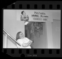 "Actress Zelda Rubenstein posing with L.A. CARES ""Play Safely"" AIDS poster in Los Angeles, Calif., 1985"