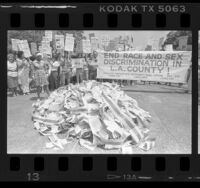 "Los Angeles County workers staging demonstration, banner reading ""End Race and Sex Discrimination in L.A. County,"" 1985"