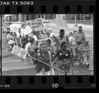 Physically disabled protestors demonstrating for mandating chairlifts on transit buses in Los Angeles, Calif., 1985