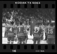 Hockey players watching presentation of flags at Los Angeles Kings vs Russia's Red Army game, Calif., 1985