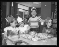 Youngsters make Hamentaschen cookies for Purim Festival, Calif., 1958