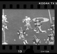 Eric Ball running ball during UCLA vs Iowa Hawkeyes football game, 1986