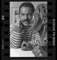 "Leonard Simon with Valerie Maynard's Monzini bronze ""We Are Tied to the Very Beginning,"" 1986"