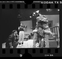 "Playwright Luis Valdez with the cast of ""I Don't Have to Show You No Stinking Badges,"" Los Angeles, Calif., 1986"
