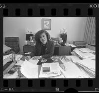 Rose Ochi, executive assistant to Mayor Tom Bradley, at her desk in Los Angeles City Hall, Calif., 1986