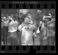 Mexican Indians led by Mayan Elder Hunbatz Men holding ceremony at statue of Aztec emperor Cuauhtemoc in Los Angeles, Calif., 1986