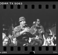Vietnam veterans standing to applauds at benefit event by comedian Fred Travalena in Los Angeles, Calif., 1986