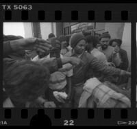 Homeless people receiving food hand-outs outside of Los Angeles County Board of Supervisors meeting, Calif., 1986