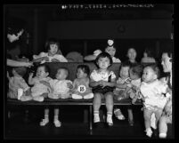 Japanese American children (contestants) at annual baby show during Nisei Week Festival in Los Angeles, Calif., 1938