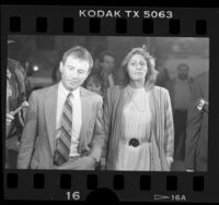 Valerie Terrigno with attorney Howard Weitzman leaving court after her embezzlement conviction in West Hollywood, Calif., 1986