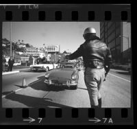 California Highway Patrol officers conducting drunk driving check-point on Sunset Blvd. in Los Angeles, Calif., 1967